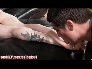 Hot red head gives footjob under christmas tree for fuckedfeet
